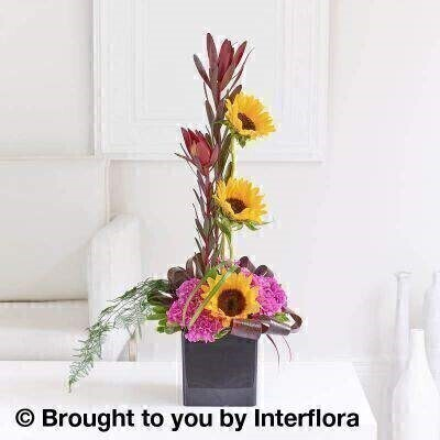 Retro Chic Sunflower and Leucadendron Arrangement: Booker Flowers and Gifts