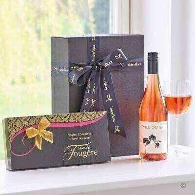 THIS PRODUCT CONTAINS ALCOHOL AND AS SUCH SHOULD ONLY BE BOUGHT FOR SOMEONE OVER THE AGE OF 18 This stylish gift box combines a bottle of Wild Orchid Rose Wine with delicious dessert chocolates from Maison Fougere a perfect combination.
