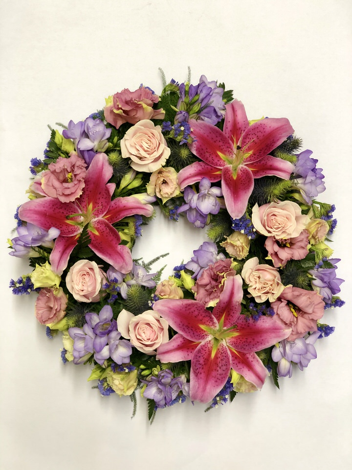 Rose and Lilly Wreath in Pink and Lilac | Funeral Flowers