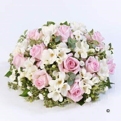 A beautiful scented posy including scented freesias - roses and september flower in soft pink and white.