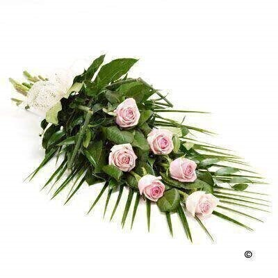 6 large-headed pink roses are presented with aralia leaves, French ruscus and eucalyptus to create this simple, classic rose sheaf.