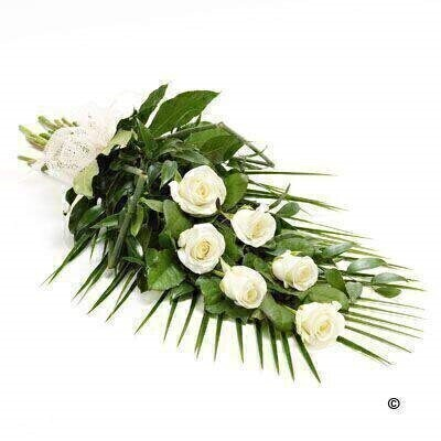 6 large-headed white roses are presented with aralia leaves - French ruscus and eucalyptus to create this simple - classic rose sheaf.