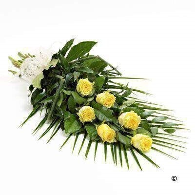 6 large-headed yellow roses are presented with aralia leaves, French ruscus and eucalyptus to create this simple, classic rose sheaf.