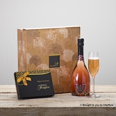 THIS PRODUCT CONTAINS ALCOHOL AND AS SUCH SHOULD ONLY BE BOUGHT FOR SOMEONE OVER THE AGE OF 18 Celebrate a special occasion in style with this magnificent combination of sparkling Rose wine and delicious Maison Fougere chocolates.