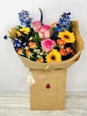 Summer Bouquet of Flowers - Hand DeliveredHand arranged by our florists into a beautiful hand-tied bouquetTo give you the best occasionally we may make substitutesOur flowers backed by our 7 days freshness guaranteeApproximate dimensions 48cmx42cmThis product is available for UK deliveryThese beautiful seasonal flowers hand arranged by our professional florists into a handtied bouquet are a delightful choice from our new Summer collection. This bouquet of flowers would make the perfect gift to let someone know you are thinking of them. Also available in a larger size.Featuring 3 blue agapanthus 3 cerise germini 3 orange spray roses 3 yellow medium headed roses and 2 alchemilla mollis together with mixed foliage all hand arranged into a handtied bouquet and presented in eco-friendly giftwrap and presentation box. Plus all our bouquets and plants have a small wooden ladybird hidden in somewhere so dont forget to spot the ladybird on our social media pages!Liverpool Flower DeliveryWe offer advanced booking flower delivery same day flower delivery 3 hour Flower delivery guaranteed AM PM or Evening Flower Delivery and offer Mothers Day delivery on Sunday Flower Delivery.The best florist in LiverpoolCome to Booker Flowers and Gifts Liverpool for your Beautiful Flowers and Plants if you really want to spoil we also have a great range of Local Gin Wines Champagne Balloons Vases and Chocolates that can be delivered with your flowers. To see the full range see our extras section. You can trust Booker Flowers and Gifts can deliver the very best for you.