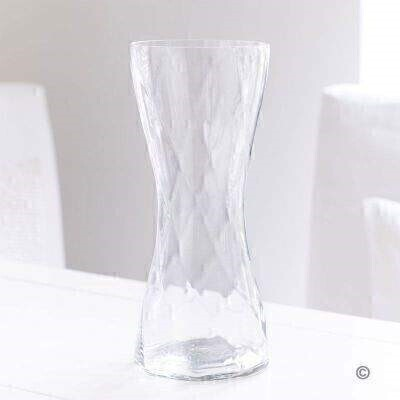 This elegant clear glass vase features a stylish twisted design that captures the light from every direction. Their flowers will look lovely — and the vase can be used and enjoyed again and again.<br><br>The vase is 30cm tall and 13cm in diameter.