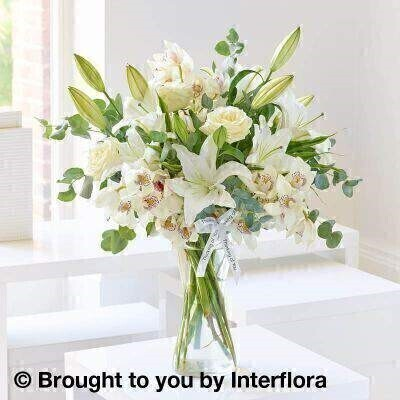 All White Flowers  Flowers in a Vase<br><br>Liverpool Flower Delivery<br><br>We offer advanced booking flower delivery same day flower delivery 3 hour Flower delivery guaranteed AM PM or Evening Flower Delivery and we are now offering Sunday Flower Delivery. .<br><br>Hand arranged by our florists To give the best occasionally we may make substitutes Our flowers backed by our 7 days freshness guarantee Approximate dimensions 60x50cm This product is available for delivery throughout the UK<br><br>THIS PRODUCT IS HAND Arranged AND COMES IN THE VASE Simply stunning. Every immaculate white petal in this magical arrangement seems to almost shimmer in the light as each perfect flower complements the next. To create this wonderful effect we've chosen the finest quality lilies orchids and pristine roses. A gorgeous gift.<br><br>Featuring 3 white Oriental lilies 3 ivory large headed roses and 3 white mini cymbidium orchids with eucalyptus and variegated dracaena presented in a tall twist glass vase and trimmed with thinking of you ribbon.<br><br>The best florist in Liverpool<b><b>Come to Booker Flowers and Gifts Liverpool for your Beautiful Flowers and Plants if you really want to spoil we also have a great range of Wines Champagne Balloons Vases and Chocolates that can be delivered with your flowers. To see the full range see our extras section. You can trust Booker Flowers and Gifts can deliver the very best for you