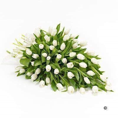 A beautiful arrangement of pure white tulips to create this simple - elegant posy.
