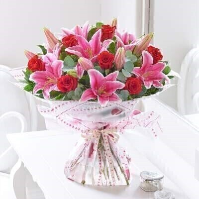 We have a gorgeous selection of Valentines flowers and this choice will not disappoint.THIS PRODUCT COMES HAND ARRANGED AND GIFT WRAPPED IN A WATER BUBBLE PRESENTED IN A BOXThey are sure to be impressed when this stunning hand-tied bouquet arrives andmdash; thereandrsquo;s just so much to admire. A celebration of pink these lilies look sensational with traditional red roses. This is the perfect gift for your loved one this Valentineandrsquo;s Day.Featuring 5 red large-headed roses 4 pink Oriental lilies eucalyptus salal and bear grass presented in Interflora gift packaging.This product contains 9 stemsBooker Flowers and Gifts are an Interflora florist based on Booker Avenue Mossley Hill South Liverpool who specialise in hand-tied bouquets. We are also an award nominated wedding florist and have been chosen by Interflora to be one of their Vera Wang speciality florists.We pride ourselves on only using top quality flowers which are individually hand arranged by one of our florists and backed by our 7 day freshness guarantee. Our flowers are perfect to make every occasion special - Birthday Flowers Anniversary Flowers Get well flowers Congratulations Flower New Baby Flowers Wedding Flowers Thank you flower Funeral Flowers and much more. We offer flower delivery to Liverpool postcode areas and we can delivery flowers for you in Liverpol Merseyside and in partnership with Interflora can organise flower delivery for you throughout the UK and even the Worldwide. We offer advanced booking flower delivery same day flower delivery 3 hour Flower delivery guaranteed AM PM or Evening Flower Delivery and we are now offering Sunday Flower Deliveries. Valentines flowers from Booker Flowers and gifts are the perfect way to say be my valentine.