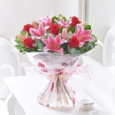 We have a gorgeous selection of Valentines flowers and this choice will not disappoint.THIS PRODUCT COMES HAND ARRANGED AND GIFT WRAPPED IN A WATER BUBBLE PRESENTED IN A BOXRoses and lilies are always a favourite combination and there is no exception for Valentineandrsquo;s Day. Weandrsquo;ve combined romantic red roses with feminine pink lilies to create a beautiful gift for your special someone.Featuring red large-headed roses pink Oriental lilies eucalyptus salal and bear grass presented in Interflora gift packaging.This product contains 7 StemsBooker Flowers and Gifts are an Interflora florist based on Booker Avenue Mossley Hill South Liverpool who specialise in hand-tied bouquets. We are also an award nominated wedding florist and have been chosen by Interflora to be one of their Vera Wang speciality florists.We pride ourselves on only using top quality flowers which are individually hand arranged by one of our florists and backed by our 7 day freshness guarantee. Our flowers are perfect to make every occasion special - Birthday Flowers Anniversary Flowers Get well flowers Congratulations Flower New Baby Flowers Wedding Flowers Thank you flower Funeral Flowers and much more. We offer flower delivery to Liverpool postcode areas and we can delivery flowers for you in Liverpol Merseyside and in partnership with Interflora can organise flower delivery for you throughout the UK and even the Worldwide. We offer advanced booking flower delivery same day flower delivery 3 hour Flower delivery guaranteed AM PM or Evening Flower Delivery and we are now offering Sunday Flower Deliveries. Valentines flowers from Booker Flowers and gifts are the perfect way to say be my valentine.