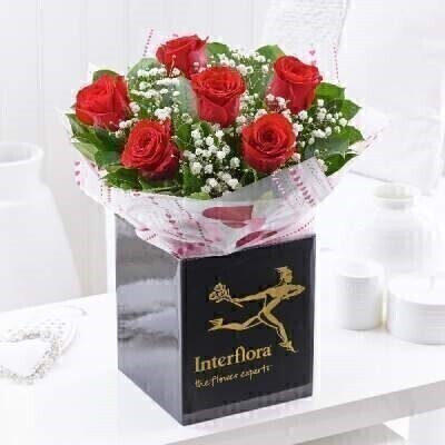 We have a gorgeous selection of Valentines flowers and this choice will not disappoint.THIS PRODUCT COMES HAND ARRANGED AND GIFT WRAPPED IN A WATER BUBBLE PRESENTED IN A BOXA classic timeless gift of half a dozen red roses is sure to delight her this Valentines Day. Here we have chosen the finest quality Freedom roses for their soft velvety petals and rich depth of crimson colour. They are all beautifully presented to ensure their natural radiance shines out.Featuring 6 large headed red Freedom roses with white gypsophila and salal leaves wrapped and trimmed with a valentines ribbon and presented in Interflora gift packaging.This product contains 6 stems.Booker Flowers and Gifts are an Interflora florist based on Booker Avenue Mossley Hill South Liverpool who specialise in hand-tied bouquets. We are also an award nominated wedding florist and have been chosen by Interflora to be one of their Vera Wang speciality florists.We pride ourselves on only using top quality flowers which are individually hand arranged by one of our florists and backed by our 7 day freshness guarantee. Our flowers are perfect to make every occasion special - Birthday Flowers Anniversary Flowers Get well flowers Congratulations Flower New Baby Flowers Wedding Flowers Thank you flower Funeral Flowers and much more. We offer flower delivery to Liverpool postcode areas and we can delivery flowers for you in Liverpol Merseyside and in partnership with Interflora can organise flower delivery for you throughout the UK and even the Worldwide. We offer advanced booking flower delivery same day flower delivery 3 hour Flower delivery guaranteed AM PM or Evening Flower Delivery and we are now offering Sunday Flower Deliveries. Valentines flowers from Booker Flowers and gifts are the perfect way to say be my valentine.