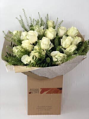 We have a gorgeous selection of Valentines flowers and this choice will not disappoint.<br><br>THIS PRODUCT COMES HAND ARRANGED AND GIFT WRAPPED IN A WATER BUBBLE PRESENTED IN A BOX<br><br>Classic beautiful and wonderfully expressive — Sending a bouquet of beautiful roses says it all. And you can relax in the knowledge that your Interflora florist will select the Featuring large-headed white roses hand-tied with gypsophila and salal leaves and presented in Interflora Gift Packaging.<br><br>Approx Dimensions - Height: 50-55cm Width: 40cm<br><br>Booker Flowers and Gifts are an Interflora florist based on Booker Avenue Mossley Hill South Liverpool who specialise in hand-tied bouquets. We are also an award nominated wedding florist and have been chosen by Interflora to be one of their Vera Wang speciality florists.<br><br>We pride ourselves on only using top quality flowers which are individually hand arranged by one of our florists and backed by our 7 day freshness guarantee. Our flowers are perfect to make every occasion special - Birthday Flowers Anniversary Flowers Get well flowers Congratulations Flower New Baby Flowers Wedding Flowers Thank you flower Funeral Flowers and much more.<br><br> We offer flower delivery to Liverpool postcode areas and we can delivery flowers for you in Liverpol Merseyside and in partnership with Interflora can organise flower delivery for you throughout the UK and even the Worldwide. We offer advanced booking flower delivery same day flower delivery 3 hour Flower delivery guaranteed AM PM or Evening Flower Delivery and we are now offering Sunday Flower Deliveries.<br><br> Valentines flowers from Booker Flowers and gifts are the perfect way to say be my valentine.