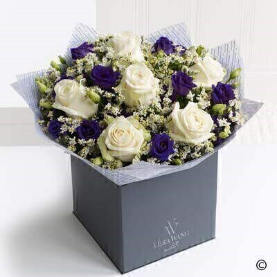 This stunning Vera Wang bouquet is a wonderfully romantic mix of exquisite creamy coloured roses - rich purple double lisianthus and silvery white limonium - lovingly hand-tied and finished with glossy green leaves. The effect is chic and incredibly beautiful.   Featuring Ice Bear cream roses - purple double lisianthus and fresh limonium - expertly hand-tied and finished with luxurious Vera Wang gift wrapping.