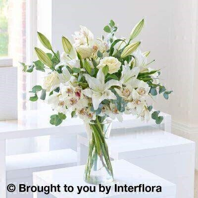 White Lilly and Orchid Vase Arrangement: Booker Flowers and Gifts