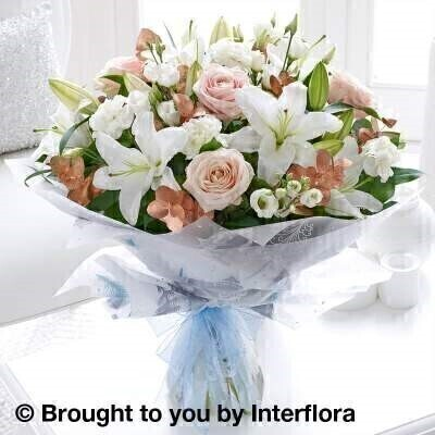 <h1>Flowers Delivered Liverpool</h1><br><br> This unusual combination of purest white with pale pink and warm copper tones looks just fantastic. White is the traditional shade for wintery flowers – here the addition of slightly warmer tones adds an extra touch of class to this stylish bouquet.<br><br>   Featuring white Oriental lily white carnations white lisianthus and pink large headed roses with copper eucalyptus and salal wrapped and trimmed with a ribbon<br><br> We offer advanced booking flower delivery same day flower delivery 3 hour Flower delivery guaranteed AM PM or Evening Flower Delivery and we are now offering Sunday Flower Delivery.<br><br><ul><li>This product is hand arranged and comes in a water bubble<li><li> To give the best occasionally we may make substitutes </li><li>Our flowers backed by our 7 days freshness guarantee</li><li> Approximate dimensions 50x45cm </li><li>This product is available for delivery throughout the UK </li></ul><br><br>The best florist in Liverpool<br><br>  Come to Booker Flowers and Gifts Liverpool for your Beautiful Flowers and Plants if you really want to spoil we also have a great range of Wines Champagne Balloons Vases and Chocolates that can be delivered with your flowers. To see the full range see our extras section. You can trust Booker Flowers and Gifts can deliver the very best for you