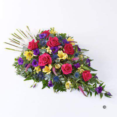 Large-headed roses - lisianthus - alstroemeria and veronica in pretty pinks - lilacs and creams are set off by blue eryngium - luxury foliages and a natural ribbon bow to create this woodland spray.