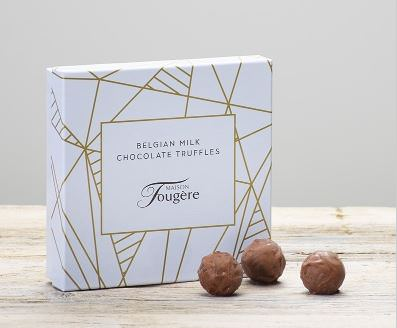 THIS ITEM WILL NEED TO ACCOMPANY A FLOWER ORDER OR BE A COMBINATION OF EXTRA ITEMS TO REACH OUR MINIMUM ORDER OF 25<br><br> Treat their taste buds to a wonderful surprise with this elegantly presented box of a dozen luxury truffles. Inside they'll discover a mix of milk and dark chocolates for them to savour — or maybe even share?<br><br> This product does not contain any artificial colours or flavours. Contains: Milk  Lactose and Gluten. May contain tree nuts and soya.<br><br> This product is alcohol free. This product is suitable for vegetarians.