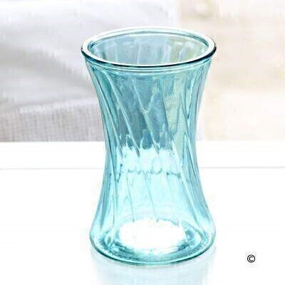 <p>This ice-blue curved glass vase with a swirl effect is the perfect finishing touch for any of our bouquets, and makes a lovely keepsake that can be used all year round.<br /><br />Height: 19cm, Vase Top Diameter: 12cm.</p>