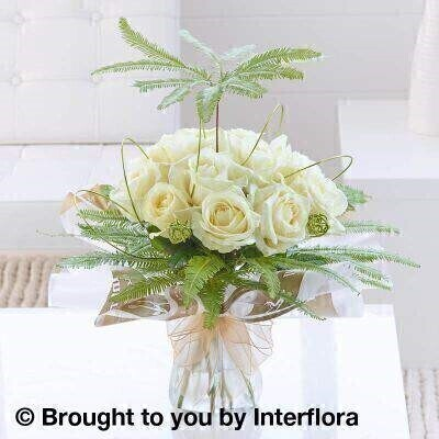 White Flowers –Box of Flowers<br><br> Liverpool Flower Delivery<br><br> We offer advanced booking flower delivery same day flower delivery 3 hour Flower delivery guaranteed AM PM or Evening Flower Delivery and we are now offering Sunday Flower Delivery. .<br><br> <ul><li>Hand arranged by our florists</li><li> To give the best occasionally we may make substitutes</li><li> Our flowers backed by our 7 days freshness guarantee</li><li> Approximate dimensions 45x40cm</li><li> This product is available for delivery throughout the UK</li></ul><br><br>  THIS PRODUCT COMES HAND ARRANANGED AND GIFT WRAPPED IN A WATER BUBBLE PRESENTED IN A BOX This beautifully presented hand-tied is also a little bit quirky. A traditional bouquet of pure white roses shelters beneath a foliage umbrella  artfully formed from aluminium wire and ferns.<br><br>  Featuring 12 white large headed roses with umbrella fern  wrapped and trimmed with gold organza ribbon and presented in luxury Interflora packaging.<br><br> The best florist in Liverpool<b><b>Come to Booker Flowers and Gifts Liverpool for your Beautiful Flowers and Plants if you really want to spoil we also have a great range of Wines Champagne Balloons Vases and Chocolates that can be delivered with your flowers. To see the full range see our extras section. You can trust Booker Flowers and Gifts can deliver the very best for you
