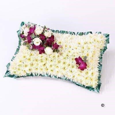 A classic pillow-shaped design created using a mass of white double spray chrysanthemums and finished with a spray of white large-headed roses and purple dendrobium orchids.