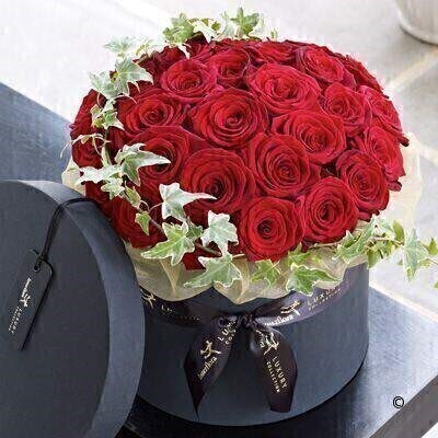 The Extra Large version on the Luxury Grand Prix Rose Hatbox. andnbsp;This elegant arrangement of premium roses makes a truly luxurious gift. The Grand Prix roses are a stunning large-headed variety with sumptuous - velvet petals in an eye-catching shade of deep scarlet. Decorated with ivy and presented in a stylish hatbox - this is a chic choice. Featuring the freshest Grand Prix roses - expertly arranged with variegated ivy trails in a stylish black hatbox - and presented in luxurious packaging for maximum impact when your gift is delivered.