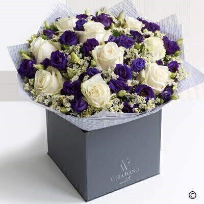 Extra large verstion of the Vera Wang Dreamy Romance. andnbsp;This stunning Vera Wang bouquet is a wonderfully romantic mix of exquisite creamy coloured roses - rich purple double lisianthus and silvery white limonium - lovingly hand-tied and finished with glossy green leaves. The effect is chic and incredibly beautiful. Featuring Ice Bear cream roses - purple double lisianthus and fresh limonium - expertly hand-tied and finished with luxurious Vera Wang gift wrapping.
