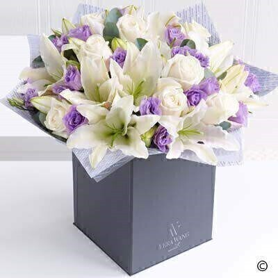 The Extra Large Version on the Ver Wang Scented Delight. andnbsp;This elegant and effortlessly beautiful Vera Wang bouquet celebrates the much loved combination of roses and lilies. The serene blanket of cream is only broken by the flashes of purple from the carefully interspersed lilac lisianthus - and the glorious scent from the Oriental lilies is the perfect finishing touch. Just exquisite.
