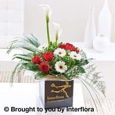 Red and White Flowers –Box of Flowers<br><br> Liverpool Flower Delivery<br><br> We offer advanced booking flower delivery same day flower delivery 3 hour Flower delivery guaranteed AM PM or Evening Flower Delivery and we are now offering Sunday Flower Delivery. .<br><br> <ul><li>Hand arranged by our florists</li><li> To give the best occasionally we may make substitutes</li><li> Our flowers backed by our 7 days freshness guarantee</li><li> Approximate dimensions 60x60cm</li><li> This product is available for delivery throughout the UK</li></ul><br><br>  THIS PRODUCT COMES HAND ARRANANGED AND GIFT WRAPPED IN A WATER BUBBLE PRESENTED IN A BOX Designed to impress  romantic red roses are combined with white germini and ornamental grasses to form a highly decorative and dramatic bouquet.<br><br>  Featuring 2 white calla lilies  4 white germini  2 green hypericum and 6 red large headed roses with Lily and China grass  asparagus fern  aspidistra. Aralia and palm leaves  bear grass  phormium and pittosporum  wrapped and trimmed with gold organza ribbon and presented in luxury Interflora packaging.<br><br> The best florist in Liverpool<b><b>Come to Booker Flowers and Gifts Liverpool for your Beautiful Flowers and Plants if you really want to spoil we also have a great range of Wines Champagne Balloons Vases and Chocolates that can be delivered with your flowers. To see the full range see our extras section. You can trust Booker Flowers and Gifts can deliver the very best for you