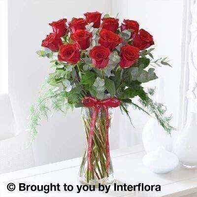 Red Flowers –Vase of Flowers<br><br> Liverpool Flower Delivery<br><br> We offer advanced booking flower delivery same day flower delivery 3 hour Flower delivery guaranteed AM PM or Evening Flower Delivery and we are now offering Sunday Flower Delivery. .<br><br> <ul><li>Hand arranged by our florists</li><li> To give the best occasionally we may make substitutes</li><li> Our flowers backed by our 7 days freshness guarantee</li><li> Approximate dimensions 55x45cm</li><li> This product is available for delivery throughout the UK</li></ul><br><br>  THIS PRODUCT IS HAND  Arranged AND COMES IN THE VASE Classic and with a timeless charm and elegance  this beautiful gift of red roses is still one of the most evocative gestures. This selection of large-headed scarlet roses looks simply magnificent arranged in a tall  elegant glass vase. It's a traditional gift that can be displayed on arrival.<br><br>  Featuring large-headed red roses with foliage  presented in a tall twist glass vase and trimmed with an  Anniversary  ribbon.<br><br> The best florist in Liverpool<b><b>Come to Booker Flowers and Gifts Liverpool for your Beautiful Flowers and Plants if you really want to spoil we also have a great range of Wines Champagne Balloons Vases and Chocolates that can be delivered with your flowers. To see the full range see our extras section. You can trust Booker Flowers and Gifts can deliver the very best for you