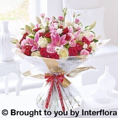 Pink Red and white Flowers – Luxury Flowers <br><br> Liverpool Flower Delivery<br><br> We offer advanced booking flower delivery same day flower delivery 3 hour Flower delivery guaranteed AM PM or Evening Flower Delivery and we are now offering Sunday Flower Delivery. .<br><br> <ul><li>Hand arranged by our florists</li><li> To give the best occasionally we may make substitutes</li><li> Our flowers backed by our 7 days freshness guarantee</li><li> Approximate dimensions 55x60cm</li><li> This product is available for delivery throughout the UK</li></ul><br><br>  THIS PRODUCT COMES HAND ARRANANGED AND GIFT WRAPPED IN A WATER BUBBLE PRESENTED IN A BOX From pink sapphires to red rubies and shimmering white pearls  the colour and richness of our favourite jewels are the inspiration for this magnificent bouquet. Diamante sparkles add to the glamour exuding from this sensational hand-tied of luxurious roses  lilies and fresh lisianthus.<br><br>  Featuring 25 red Naomi large headed roses  10 pink large headed roses  10 ivory large headed roses  5 pink lisianthus  5 white lisianthus and 5 pink Oriental lilies with dracaena and salal  wrapped and trimmed with Happy Anniversary ribbon and 10 long diamante pins.<br><br> The best florist in Liverpool<b><b>Come to Booker Flowers and Gifts Liverpool for your Beautiful Flowers and Plants if you really want to spoil we also have a great range of Wines Champagne Balloons Vases and Chocolates that can be delivered with your flowers. To see the full range see our extras section. You can trust Booker Flowers and Gifts can deliver the very best for you