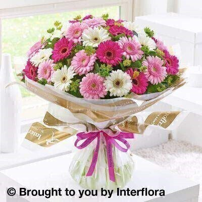 Pink and white Flowers – Bouquet in a Box <br><br> Liverpool Flower Delivery<br><br> We offer advanced booking flower delivery same day flower delivery 3 hour Flower delivery guaranteed AM PM or Evening Flower Delivery and we are now offering Sunday Flower Delivery. .<br><br> <ul><li>Hand arranged by our florists</li><li> To give the best occasionally we may make substitutes</li><li> Our flowers backed by our 7 days freshness guarantee</li><li> Approximate dimensions 45x50cm</li><li> This product is available for delivery throughout the UK</li></ul><br><br>  THIS PRODUCT COMES HAND ARRANANGED AND GIFT WRAPPED IN A WATER BUBBLE PRESENTED IN A BOX This bouquet of cheery germini in shades of pink and white is wonderfully informal  yet fun too. The germini is a fashionable choice  so this beautiful hand-tied selection is sure to prompt a radiant smile when it arrives on their special day.<br><br>  Featuring pink germini  white germini and cerise germini with green bupleurum and salal  wrapped and trimmed with a Happy Birthday ribbon.<br><br> The best florist in Liverpool<b><b>Come to Booker Flowers and Gifts Liverpool for your Beautiful Flowers and Plants if you really want to spoil we also have a great range of Wines Champagne Balloons Vases and Chocolates that can be delivered with your flowers. To see the full range see our extras section. You can trust Booker Flowers and Gifts can deliver the very best for you