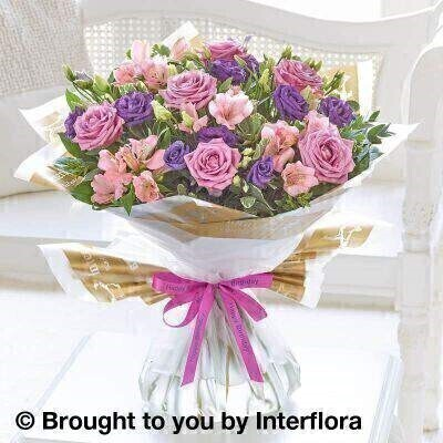 Pink and Purple Flowers – Bouquet in a Box <br><br> Liverpool Flower Delivery<br><br> We offer advanced booking flower delivery same day flower delivery 3 hour Flower delivery guaranteed AM PM or Evening Flower Delivery and we are now offering Sunday Flower Delivery. .<br><br> <ul><li>Hand arranged by our florists</li><li> To give the best occasionally we may make substitutes</li><li> Our flowers backed by our 7 days freshness guarantee</li><li> Approximate dimensions 50x42cm</li><li> This product is available for delivery throughout the UK</li></ul><br><br>  THIS PRODUCT COMES HAND ARRANANGED AND GIFT WRAPPED IN A WATER BUBBLE PRESENTED IN A BOX This elegant bouquet is a delightful choice for someone special. A sophisticated colour palette of pink  lilac and purple brings out the natural beauty of each flower – and the real stars are these Cool Water roses in their distinctive shade of dusky lilac.<br><br>  Featuring pink alstroemeria  blue lisianthus and lilac Cool Water large headed roses with eucalyptus  pittosporum and salal  wrapped and trimmed with a Happy Birthday ribbon.<br><br> The best florist in Liverpool<b><b>Come to Booker Flowers and Gifts Liverpool for your Beautiful Flowers and Plants if you really want to spoil we also have a great range of Wines Champagne Balloons Vases and Chocolates that can be delivered with your flowers. To see the full range see our extras section. You can trust Booker Flowers and Gifts can deliver the very best for you