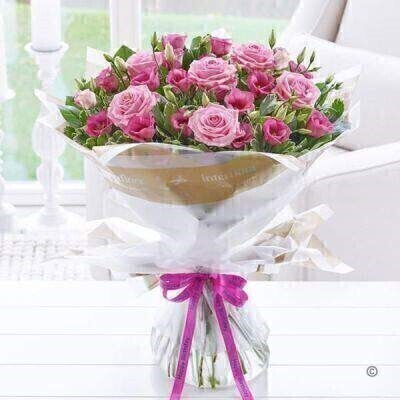 THIS PRODUCT COMES HAND ARRANGED AND GIFT WRAPPED IN A WATER BUBBLE PRESENTED IN A BOX Fresh roses and lilies are two of our most popular flower choices and this magnificent bouquet combines both to glorious effect. The richness of these classic roses and velvety textured lilies is perfect for a birthday bouquet. It's sure to make them feel very special too. Featuring pink Oriental lilies and pink large headed roses with salal and eucalyptus wrapped and trimmed with andlsquo;Happy Birthday' ribbon and presented in Interflora Gift Packaging.
