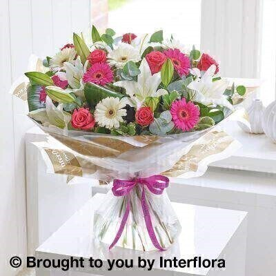 Pink and white Flowers – Bouquet in a Box <br><br> Liverpool Flower Delivery<br><br> We offer advanced booking flower delivery same day flower delivery 3 hour Flower delivery guaranteed AM PM or Evening Flower Delivery and we are now offering Sunday Flower Delivery. .<br><br> <ul><li>Hand arranged by our florists</li><li> To give the best occasionally we may make substitutes</li><li> Our flowers backed by our 7 days freshness guarantee</li><li> Approximate dimensions 52x50cm</li><li> This product is available for delivery throughout the UK</li></ul><br><br>  THIS PRODUCT COMES HAND ARRANANGED AND GIFT WRAPPED IN A WATER BUBBLE PRESENTED IN A BOX This design is all about contrast. The rich shades of hot pink and cerise look stunning with pristine white and lush green. Notice too  the lovely contrast between the smooth star-shaped lily petals  the classic rose blooms and the cheery circular germini flowers. A gorgeous gift.<br><br>  Featuring cerise germini  white Oriental lilies  cerise large headed roses and white germini  with folded aspidistra leaves  eucalyptus  salal and pittosporum  wrapped and trimmed with a Happy Birthday ribbon.<br><br> The best florist in Liverpool<b><b>Come to Booker Flowers and Gifts Liverpool for your Beautiful Flowers and Plants if you really want to spoil we also have a great range of Wines Champagne Balloons Vases and Chocolates that can be delivered with your flowers. To see the full range see our extras section. You can trust Booker Flowers and Gifts can deliver the very best for you