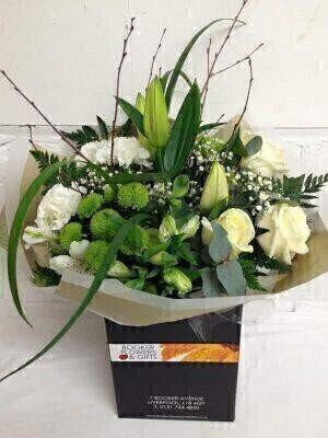 Not sure what flowers to choose – then leave it to us at Booker Flowers and Gifts and our skilled Florists to make a beautiful bouquet in harmonious Green and White Flowers. We will choose the flowers that we think are the strongest and most beautiful at the time. The picture shows an example bouquet with yours containing seasonal flowers similar colour texture and vibrancy. As our flowers are fresh and seasonal substitutions will be made where necessary this ensures you get the very best flowers to form your beautiful bouquet in look and longevity.<br><br>  THIS PRODUCT COMES HAND ARRANANGED AND GIFT WRAPPED IN A WATER BUBBLE PRESENTED IN A BOX<br><br>  The picture is an example of the colour palette and types of flowers we will use - actual content may vary but they will be green and white and they will be BEAUTIFUL.<br><br>  There is nothing more calming and classic as a bouquet made from green and white flowers they suit every decor and bring a sense of harmony to your world.<br><br>  In this example we have mixed Oriental Lily White Roses White Carnations Gypsophilia Alstromeria green Chrysanthemums greenery and birch twigs and grasses to give a natural calming look. Some of our flowers are arranged in bud which means that the bouquet will look different in a few days in a warm house when the lilies and alstromeria have opened showing their full colour and beauty. Our flowers are guaranteed for 7 days but this combination should last a lot longer<br><br>  Booker Flowers and Gifts are an Interflora florist based on Booker Avenue Mossley Hill South Liverpool <br><br>  We pride ourselves on only using top quality flowers which are individually hand arranged by one of our florists and backed by our 7 day freshness guarantee<br><br>  We offer advanced booking flower delivery same day flower delivery 3 hour Flower delivery guaranteed AM PM or Evening Flower Delivery and we are now offering Sunday Flower Deliveries.<br><br>  The calming and neutral tone of this green and white bouquet make is suitable for many occasions such as Birthday Sympathy or Just Because. Green and white flowers are the perfect way to bring beauty and natural calming tones bringing the simple beauty of nature indoors. You can trust Booker Flowers and Gifts can deliver the very best for you.