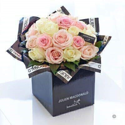 Captivating romantic irresistible — this gorgeous bouquet shows how breathtakingly beautiful fresh flowers can reflect an individual or a mood just perfectly. This bouquet is a harmonious selection of premium quality roses in soft pinks and pristine white — expertly hand-tied for optimum impact.<br><br>Featuring 8 light pink large headed roses 8 white large headed roses and 8 pink large headed roses with aralia presented in Julien Macdonald foil wrap and a dual-branded gift box with designer gift tag and ribbon. This hand-tied is tightly constructed to create a neat compact posy of flowers.<br><br>This product contains 24 stems. <br><br>Approximate Product Dimensions: Height: 38cm Width: 34cm