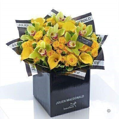 This resplendent hand-tied bouquet is a big impact gift that is sure to prompt a radiant smile of delight. We've selected these exquisite orchids with velvety green petals and hints of hot pink at the centre. Presented against a canopy of shimmering gold roses the result is sensational.<br><br>Featuring 6 green cymbidium orchids 5 yellow calla lilies 5 yellow spray roses with pittosporum and salal presented in Julien Macdonald foil wrap and a dual-branded gift box with designer gift tag and ribbon. This hand-tied is tightly constructed to create a neat compact posy of flowers.<br><br>This product contains 16 stems.<br><br>Approximate Product Dimensions: Height: 40cm Width: 40cm
