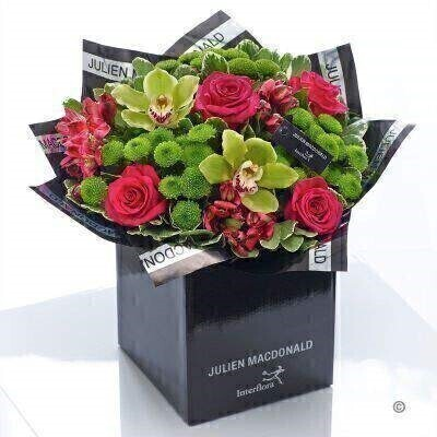 This ultra-stylish design in vibrant lime and cerise is real showstopper. We've chosen distinctive mini orchids in an exotic shade of green and partnered them with classically beautiful roses and delicately textured tiny chrysanthemums. It's an impressive gift that is rich in colour and detail.<br><br>Featuring 3 cerise alstroemeria 3 green spray chrysanthemums 4 cerise large headed roses and 2 green mini cymbidium orchids with pittosporum and salal presented in Julien Macdonald foil wrap and a dual-branded gift box with designer gift tag and ribbon. This hand-tied is tightly constructed to create a neat compact posy of flowers.<br><br>This product contains 12 stems. <br><br>Approximate Product Dimensions: Height: 38cm Width: 36cm
