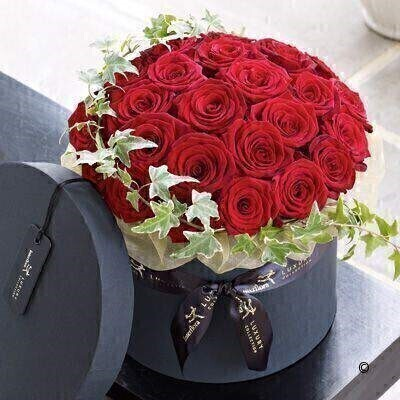The Large version on the Grad Prix Rose Hatbox. andnbsp;This elegant arrangement of premium roses makes a truly luxurious gift. The Grand Prix roses are a stunning large-headed variety with sumptuous - velvet petals in an eye-catching shade of deep scarlet. Decorated with ivy and presented in a stylish hatbox - this is a chic choice. Featuring the freshest Grand Prix roses - expertly arranged with variegated ivy trails in a stylish black hatbox - and presented in luxurious packaging for maximum impact when your gift is delivered.