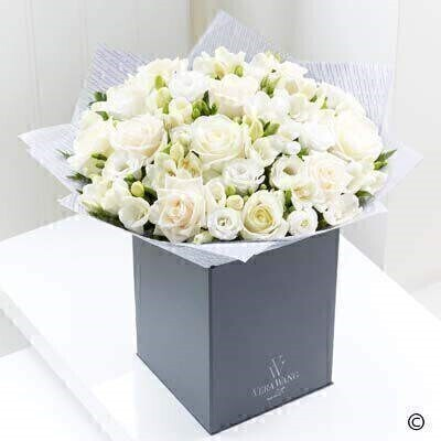 The Large version on the Vera Wang Purest Grace. andnbsp;The image of purity - perfection and grace - this Vera Wang bouquet is created from the very finest flowers. The subtle difference in tone - from warm cream to snow white - gives depth and texture - and the delicate double freesias provide a sweet fragrance which only adds to the enjoyment of this picture-perfect gift.Featuring Avalanche and Vendela cream roses - white double lisianthus and white double freesias - expertly hand-tied with salal - and finished with luxurious Vera Wang gift wrapping.