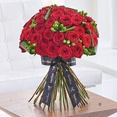 THIS PRODUCT COMES HAND ARRANGED AND GIFT WRAPPED IN A WATER BUBBLE PRESENTED IN A BOX.<br><br> The ultimate romantic gesture  this magnificent red rose bouquet is the height of sophistication. A softly rounded canopy of three dozen perfect Naomi roses is interspersed with flashes of shiny green  plus lime hypericum berries. It's a fresh  modern take on a classic gift choice.<br><br> Featuring three dozen Naomi large headed roses with green aspidistra and green Coco Bamboo hypericum  expertly hand tied and presented in luxurious packaging for maximum impact when your gift is delivered.<br><br> Approx. Height: 48cm  Width: 44cm