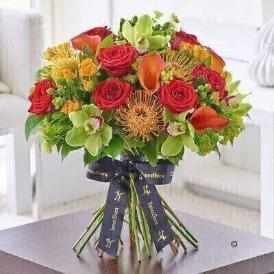 THIS PRODUCT COMES HAND ARRANGED AND GIFT WRAPPED IN A WATER BUBBLE PRESENTED IN A BOX.<br><br>Rich colours shapes and textures combine beautifully in this statement bouquet. The design brings together a wonderful selection of the most luxurious flowers including sophisticated calla lilies velvety soft red roses and distinctive green cymbidium orchids. A glorious gift choice.<br><br>Featuring orange Captain Odeon calla lilies green Alice Anderson cymbidium orchid heads in individual hydrating tubes green Coco Bamboo hypericum red Naomi large headed roses orange abeba spray roses and orange Soleil leucospermum with bupleurum and salal expertly hand-tied and presented in luxurious packaging for maximum impact when your gift is delivered.<br><br>This product contains 30 stems.<br><br>Approximate Product Dimensions:<br><br>Height: 45cm Width: 42cm