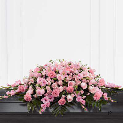 This beautiful casket spray features blushing pink Rose - spray Rose - carnations - gladioli - spray carnations and Asiatic Lily - all elegantly arranged amongst an assortment of lush greens to create a very elegant display.