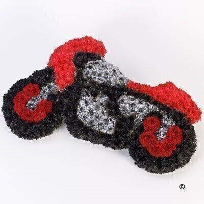 Pay tribute to their love of motorcycles with this distinctive floral display. The motorbike is covered in a bed of fresh red carnations and white double spray chrysanthemums and finished with silver - red and black spray colours.