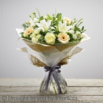 Bursting with life - this hand-tied bouquet is an exquisite display of pristine white and sunshine yellow flowers. Itandrsquo;s a lovely way to welcome a new life into the world and is sure to be received with pleasure and displayed with pride. Featuring white germini - yellow large headed roses and white Oriental lilies - hand-tied with gypsophila - aspidistra leaves - eucalyptus and salal - gift-wrapped and trimmed with a yellow andlsquo;Congratulationsandrsquo; ribbon.