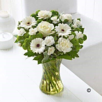 Welcome the new arrival in style with this beautiful vase of fresh flowers. With this gift weandrsquo;ve opted for natural elegance and simplicity - choosing stunning yet understated shades of cream - ivory and white - so itandrsquo;s the perfect choice to celebrate a new baby boy or baby girl. Featuring cream carnations - white germini - ivory large headed rose - green spray chrysanthemums and white spray carnations with salal and pittosporum - arranged in a lime green swirl glass vase.