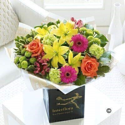 Now that baby is safely here - why not add to the joyful - celebratory mood with this showstopper bouquet of brightly coloured fresh flowers? Weandrsquo;ve chosen a vibrant colour palette of cerise - lime green - orange and yellow - the result is sure to surprise and delight them. Featuring cerise alstroemeria - green carnations - cerise germini - yellow Asiatic lilies - orange large headed roses and green spray chrysanthemums with pittosporum and salal - gift-wrapped and presented in an Interflora gift bag.