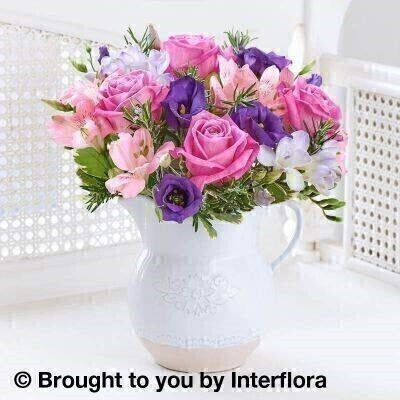 Pink and Purple Flowers – Flowers in Jug<br><br> Liverpool Flower Delivery<br><br> We offer advanced booking flower delivery same day flower delivery 3 hour Flower delivery guaranteed AM PM or Evening Flower Delivery and we are now offering Sunday Flower Delivery. .<br><br> <ul><li>Hand arranged by our florists</li><li> To give the best occasionally we may make substitutes</li><li> Our flowers backed by our 7 days freshness guarantee</li><li> Approximate dimensions 26x24cm</li><li> This product is available for delivery throughout the UK</li></ul><br><br>  THIS PRODUCT IS HAND  Arranged AND COMES IN THE VASE This floral jug arrangement is a wonderfully uplifting gift. Not only does the combination of stunning pink luxury roses and delicate lilac freesia look sensational  this gift also has a fresh fragrance to enjoy too.<br><br>  Featuring 2 lilac freesias  4 pink large headed roses  2 pink alstromeria  a purple lisianthus with rosemary and pittosporum presented in an embossed ceramic jug.<br><br> The best florist in Liverpool<b><b>Come to Booker Flowers and Gifts Liverpool for your Beautiful Flowers and Plants if you really want to spoil we also have a great range of Wines Champagne Balloons Vases and Chocolates that can be delivered with your flowers. To see the full range see our extras section. You can trust Booker Flowers and Gifts can deliver the very best for you