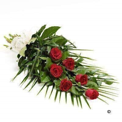 6 large-headed red roses are presented with aralia leaves - French ruscus and eucalyptus to create this simple - classic rose sheaf.