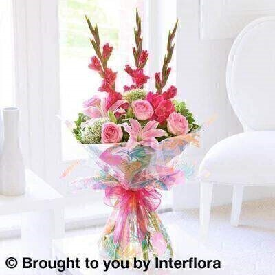 Tall  elegant gladioli are a fashionable choice this season. Here we've combined them with exquisite pink roses and lilies plus delicate white trachelium blooms for contrast and softness. This modern design is right up to date and is sure to impress when it arrives at their door.<br><br> Featuring white trachelium  pink Oriental lily  pink large headed roses and cerise gladioli with pittosporum and salal  wrapped and trimmed with cerise ribbon and presented in Interflora gift packaging.<br><br> Height: 65cm  Width: 40cm